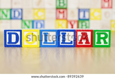 DOLLAR Spelled Out in Alphabet Building Blocks - stock photo
