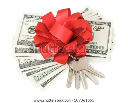 Dollar stack with red bow with keys isolated on white background. Concept