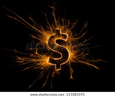 Dollar $ symbol on fire with black background and copy space.  - stock photo