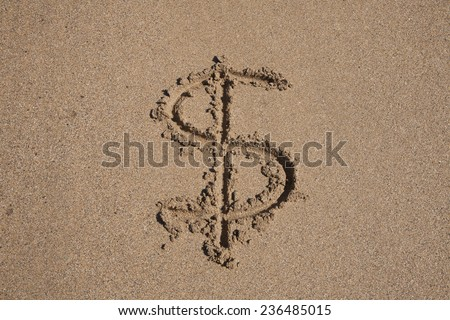 Dollar symbol written on brown sand ground low tide beach seashore - stock photo