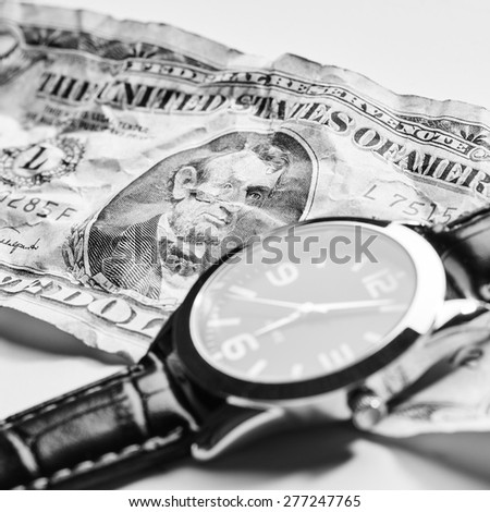 Dollar with clock on white background