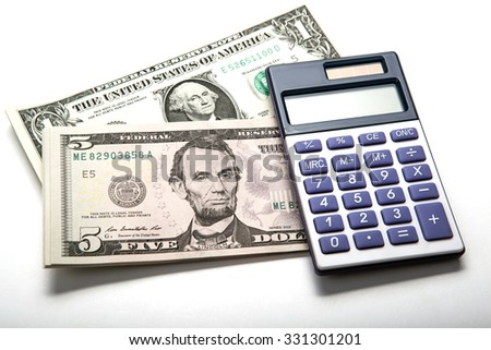dollars and calculator work close up - stock photo