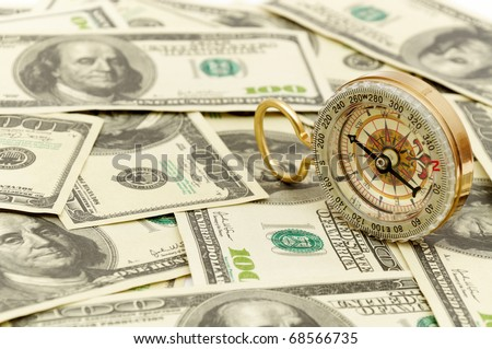 Dollars and compass. Concept about a direction in business