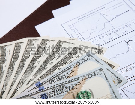 Dollars and documents - closeup shot - stock photo
