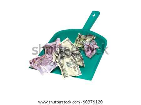 Dollars and euro bills lying on green plastic dustpan. Isolated on white with clipping path - stock photo