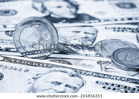 Dollars and Euro coin, Dual tone - stock photo