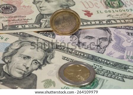 Dollars and Euro coins - stock photo