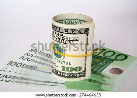 dollars and euro isolated on white background. - stock photo