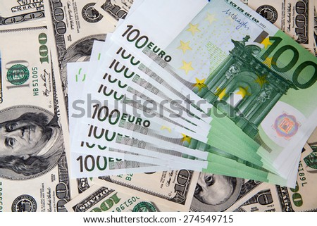 dollars and euro isolated on white background. - stock photo