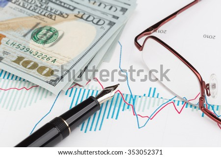 Dollars and fountain pen with eyeglasses