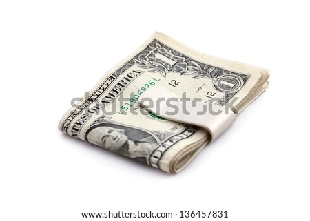 Dollars and money clip on white background.