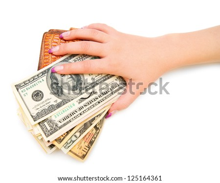 Dollars and purse in a hand. On a white background. - stock photo