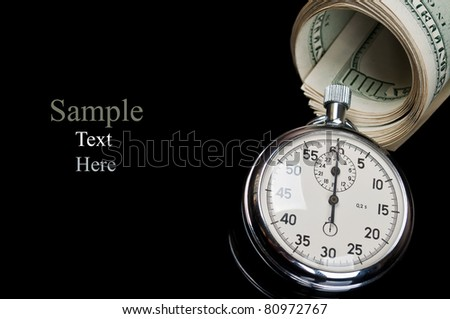 dollars and stopwatch isolated on a black background - stock photo