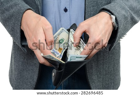 dollars and wallet in the hands of men
