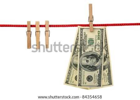 Dollars are hanging on a wooden clothespin isolated on white background