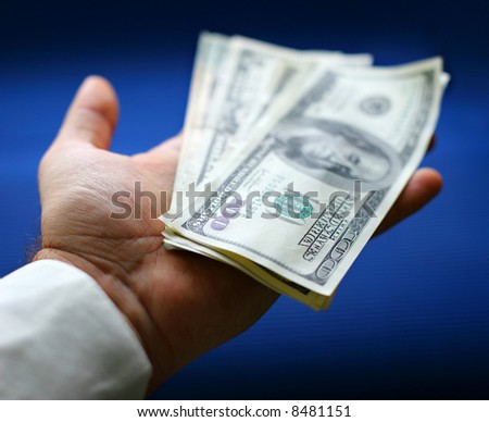Dollars are in a hand - stock photo