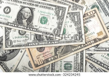 Dollars assorted bills, cash pile background - stock photo