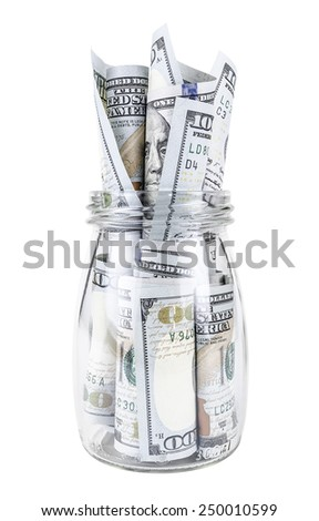 Dollars bank notes in a glass jar - stock photo