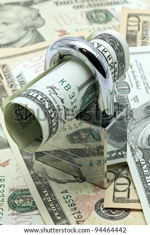 Dollars Banknote bills Locked on Cash background for Money Saving Insurance Concept - stock photo