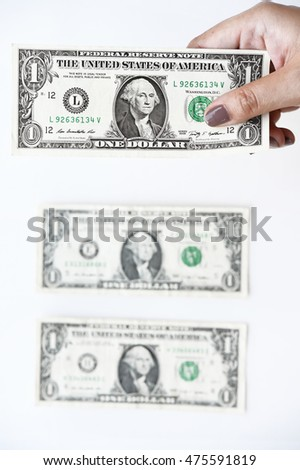 Dollars bill on hand isolated on white background