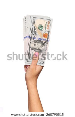 Dollars bills in female hand isolated on white. Money - stock photo