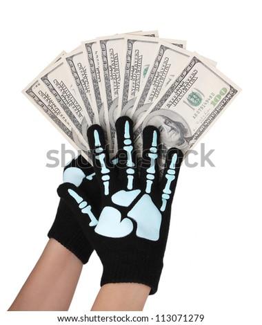 dollars bills in skeleton hands isolated on white, money - stock photo
