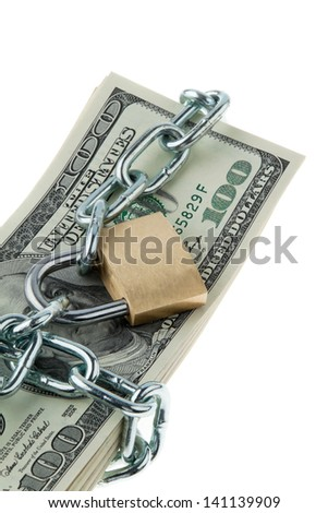 dollars bills with lock and chain. money stack for safety and investment.