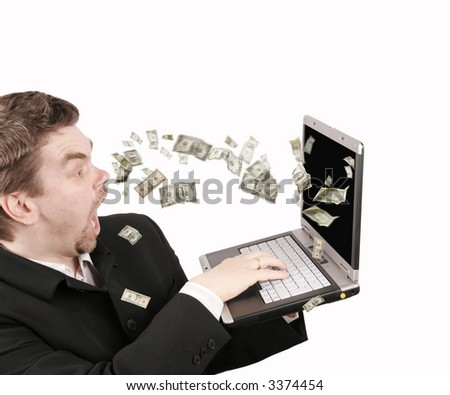 Dollars coming out from a laptop - stock photo
