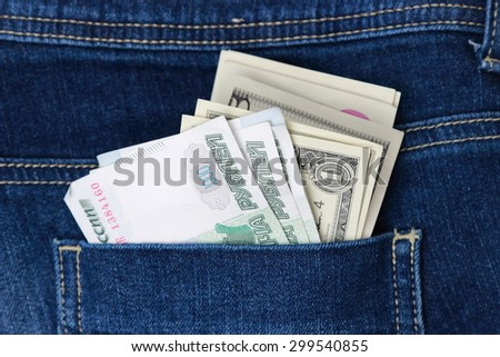 Dollars, euro and russian rubles in jeans pocket - stock photo