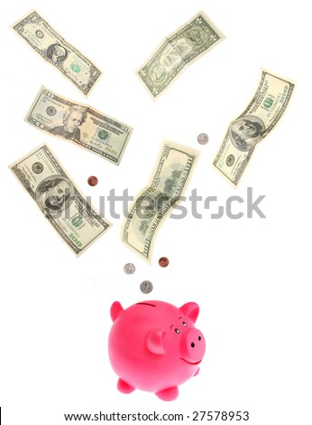 dollars falling into piggy bank isolated on white