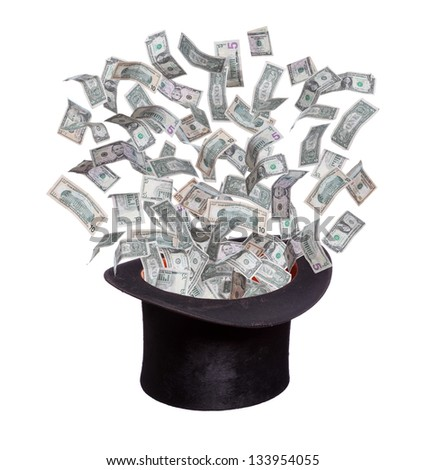 dollars flaying out of old hat - stock photo