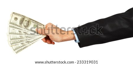 Dollars in a hand of the businessman isolated on white background - stock photo
