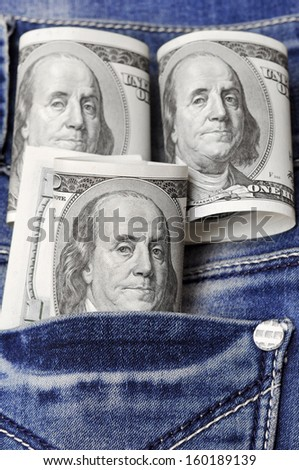 dollars in a jeans pocket
