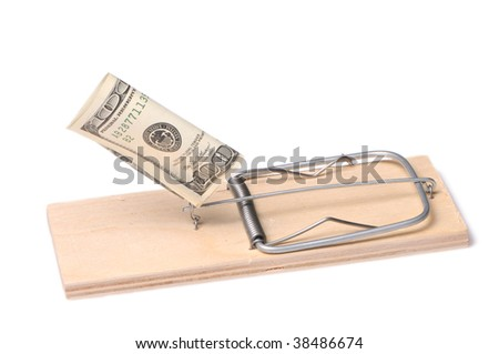 Dollars in a mousetrap - stock photo
