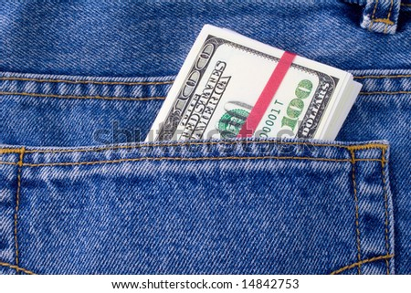 Dollars in a pocket of jeans