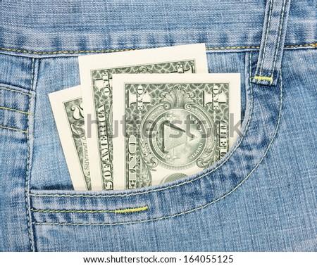 dollars in jeans pocket  - stock photo
