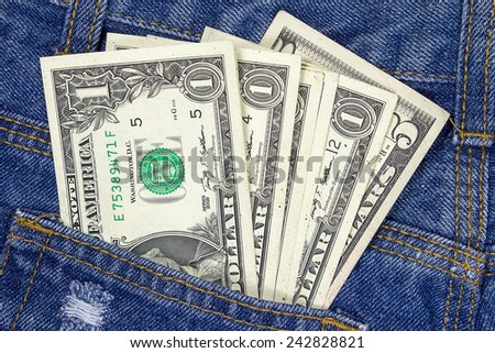 Dollars in jeans pocket