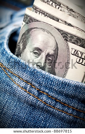 dollars in jeans pocket - stock photo