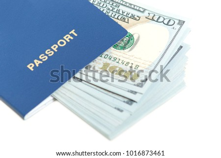 Dollars in passport isolated over white background. Foreign passport with banknote. Free travel to Europe without visa. Tourism concept. Free space for text
