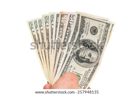 dollars in the hand on white - stock photo