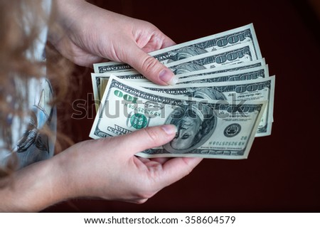 Dollars in the hands of a girl