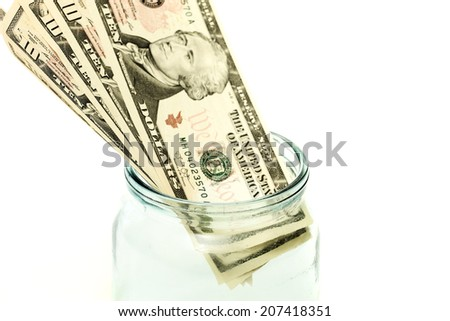 Dollars in the jar on a white background