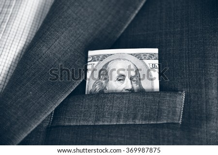 Dollars in the pocket of his jacket (corruption, lobbying, bribery - concept). Vintage effect. - stock photo