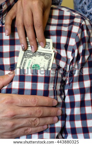 Dollars in the shirt pocket