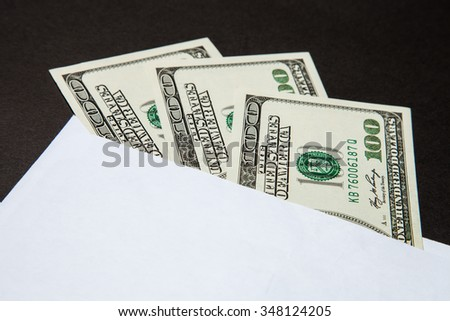Dollars in the white envelope, cover, closeup shot
