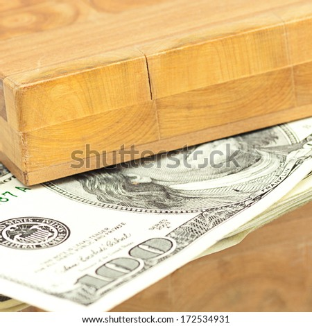 Dollars in the wooden box isolated on white - stock photo