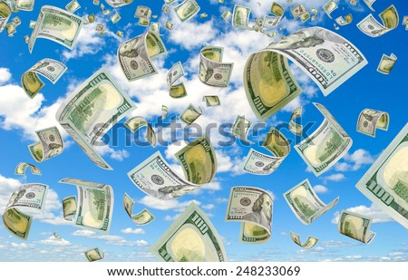 Dollars is flying in the sky. - stock photo