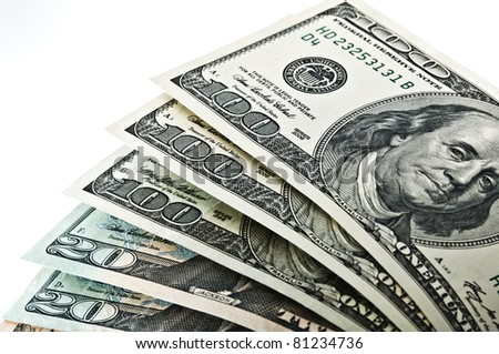Dollars of different denominations folded like a fan. - stock photo