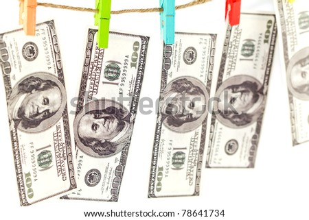 Dollars on a rope isolated on white - stock photo