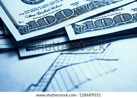 Dollars on hand drawn chart. Business concept. Toned image. - stock photo